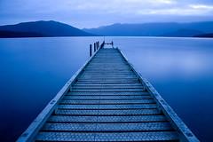 Lake Hauroko, New Zealand. (tomrobinsonphotography) Tags: longexposure blue newzealand lake glass jetty tripod chickenwire hauroko colorphotoaward manfrotto725b lpfloating