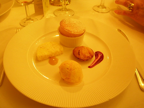 Rhubarb souffle lemon tart with a blackcurrant coulis rhubarb ripple ice cream and coconut ice with a mango dab