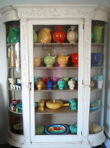 Fiestaware in a white French-esque cabinet, via Flickr: MHerron_99