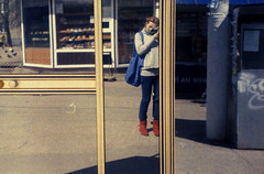 mrcz-zorki-k200_32 (mariczka) Tags: street zorki blue red selfportrait reflection film me girl face yellow analog bag outside 50mm mirror shadows boots rangefinder busstop redhead overexposed borrowedcamera kharkiv f20 kodakgold200 zorki4 audel sovietcamera autaut mariczka saltivka vintageanalogue lensjupiter8 streetselfsseries