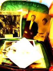 The Small Green Vintage Suitcase Cradles Family and Found Photos
