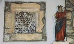 Inscription et la vierge au flambeau