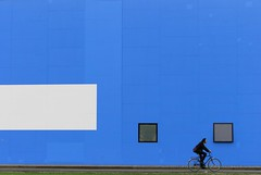 blue berlin (oljmpya) Tags: life city blue windows white man berlin colors bicycle germany person persona blu uomo cycle azzurro colori bianco soe germania italians citt finestre berlino blueribbonwinner biciletta mywinners colorphotoaward flickrdiamond oljmpya bestminimalshot thechallengefactory colorannoaprile colorannoagosto