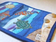 Closeup of Stitching (Pictures by Ann) Tags: ocean china blue original brown shells fish green art texture gulfofmexico water swimming swim mom book miniature 3d sand beige raw texas purple quilt expression embroidery small journal chinese creative tan shades turtles swap edge tiny koi handsewn teaching aquatic symbols applique homeschool meaning mothersday crafting homeschooling textured bot adoption proverb southpadreisland symbolism seaturtles edges meaningful tactile journalquilt frenchknots handquilted sensory swapbot redthread biastape rawedge rawedgeapplique machinequilted machinesewn maypersonal shellswithholes transparentthread