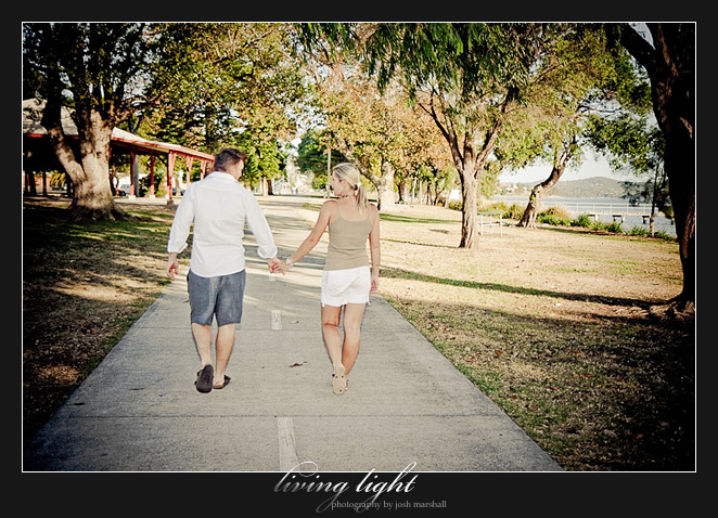 Couple walking. Engagement session at Speers Point, Lake Macquarie, Newcastle.