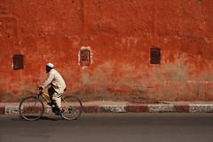 Passing the wall (mcsherryp) Tags: red morocco marrakech marrakesh enjoylife manonbike medinawall