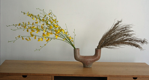 Ikebana in a U shaped vase