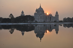 Victoria Memorial, Kolkata India (Laura Dunn-Mark) Tags: travel pink light sunset sun india reflection building monument water architecture reservoir fading 2008 kolkata calcutta victoriamemorial westbengal lauradunnmark