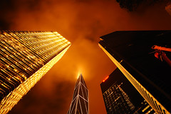 Towering Inferno (Tom Stoncel) Tags: china longexposure night nikon asia bankofchinatower hongkongisland 2470mm28 5photosaday cheungkongcenter focallength24mm d700 tomstoncel citybankplaza