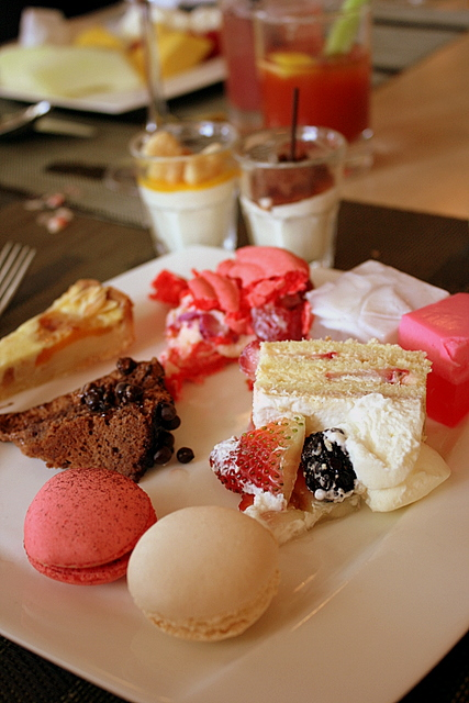 My dessert platter with macarons, strawberry shortcake, manjari chocolate cake, apricot tart, rose ispahan and Thai jellies