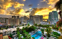 Sunset in El Condado, Puerto Rico (HisAndHerPhotographs.com) Tags: pink flowers blue trees windows sunset summer sky sun building green beach glass pool beautiful set skyline clouds photoshop canon buildings lens puerto island la living three high san apartments apartment dynamic juan cloudy puertorico outdoor vibrant balcony parking carribean el palm resort rico condo pools covered highrise rays through lovely condos concha sunrays range 450 efs 1022mm hdr condado laconcha buidlings xsi lightroom exposures cs3 photomatix elcondado 450d puertoricocity puertoricolandscape puertoricosunset puertoricopictures puertoricopicture puertoricohdr
