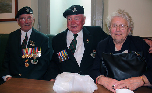 Three veterans sheltering from the rain, Arromanches, Normandy, D-day commemorations 2009