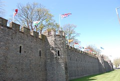 Cardiff castle, flags flying (Harle (Summer is here!)) Tags: uk blue summer england sky building castle art wall wales photography flying photo wind fort britain flag cardiff windy flags structure glamorgan walls breeze defence breezy cardiffcastle britishflag flagsflying spanishflag welshflag