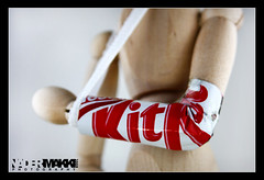 Have a BREAK .. Have a KitKat ..!! (Nader Makki) Tags: lighting light red white broken break hand sweet chocolate woody kitkat flickrsbest canon40d nadermakki