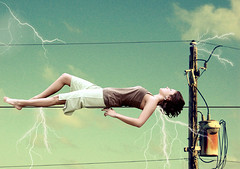 Electrical bind (.:Amanda Michelle:.) Tags: clouds canon hair poem emotion gimp powerlines electricity 10secondtimer