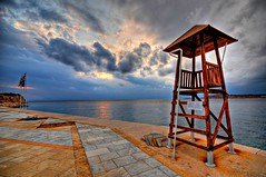No lifeguard on duty - Sunset in Vouliagmeni, Greece (5ERG10) Tags: sunset sea tower beach pool sergio clouds photoshop hotel seaside nikon europe wideangle lifeguard athens flags greece grecia handheld frontpage turret hdr highdynamicrange attica d300 aegeansea vouliagmeni 3xp photomatix atene torretta sigma1020  guardstation tonemapping astirpalace  amiti  5erg10 mikrokavouri sergioamiti
