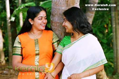Kavya Madhavan and Meera Jasmine with Kerala backdrop