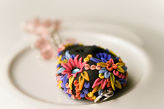 dia de los muertos pendant (Chili Crab) Tags: flowers blue orange black leaves yellow dayofthedead skull one chili purple crystal handmade ooak peach violet crab jewelry kind fimo lilac clay diadelosmuertos etsy 2009 pendant polymer swarovsky