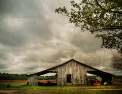 Utilitarian Beauty (evanleavitt) Tags: county wood tractor texture me beautiful barn rural ga georgia darkness decay farm south scene tools equipment soil american smell weathered to coming laurens hdr rains the photomatix