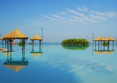 Tranquil day (juliaclairejackson) Tags: blue sea reflection pool swim hotel mirror still infinity surreal tranquility calm symmetry tenerife relaxation stillness canaryislands blueness apparation vosplusbellesphotos palaciogranmelia