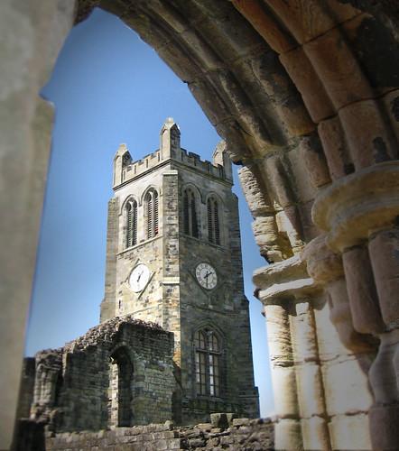 Clock tower through arch