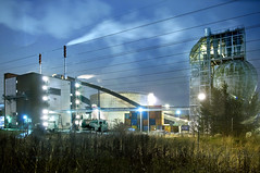 Uppsala combined heat and power plant. Central heat plant. (Vattenfall) Tags: fall night energy sweden smoke bluesky storage container peat uppsala electricity chp powerline waste climate autmn biomass transmissionline vattenfall biofuel combinedheatandpowerplant