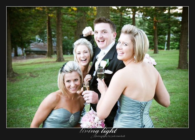 Groom with bridesmaids amongst pine trees. King Edward Park. Newcastle wedding photography.