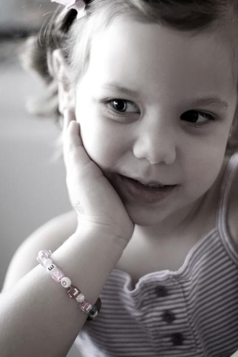 modeling her bracelet