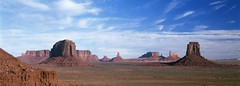 Monument Valley Panorama (richardkingphoto) Tags: blue red arizona usa southwest color colour film clouds butte az bluesky panoramic navajo monumentvalley monuments navajoreservation mesa velvia50 americansouthwest navajotribalpark castlebutte navajonation monumentvalleypark merrickbutte rightmitten thestagecoach eaglemesa thekingonhisthrone settinghen brighamstomb sentinalmesa thebearandrabbit thebigindian