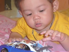 mobil (nikenrisaCantik) Tags: boy baby car yellow tooth child some mobil gigi anak lucu kuning balita