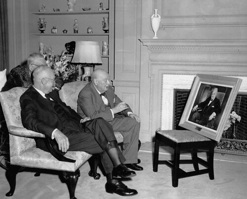 Dwight Eisenhower shows Winston Churchill the portrait he painted of the former P.M.
