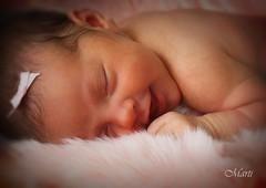 Newborn baby smiles (FLPhotonut) Tags: pink portrait baby smile fur newborn flphotonut