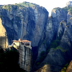 The magnificent & isolated monasteries of Meteora () (... Arjun) Tags: morning summer 15fav mountain texture church 1025fav 510fav wonderful private easter landscape worship rocks europe cross bright superb prayer sunny monk grand nun christian unescoworldheritagesite worldheritagesite holy greece glorious monastery squareformat lonely solitary desolate orthodox fortress 2009 brilliant f4 isolated marvelous magnificent splendid jamesbond jesuschrist secluded outstanding meteora 105mm kalambaka foryoureyesonly monasteries superlative iso160 friendless trikala introverted outoftheway thessaly retiring canonef24105mmf4lis bravura thessalia bluelist pindus unfrequented canoneos5dmarkii  suspendedrocks suspendedintheair canon5dmarkii intheheavensabove peneios theholymonasteryofrousanou 394251n213752e