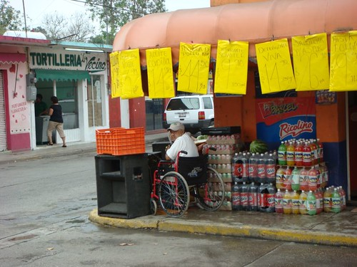 Wheel-chair man with a microphone. Aldama, Mexico.