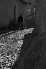 Alone with my shadow (lg.custodio) Tags: shadow bw white black portugal canon eos flickr alone walk xs castelonovo blackwhitephotos visitportugal ilustrarportugal 1000d lgcustodio fundao