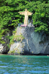 Saint at the Lake (cwgoodroe) Tags: sun mountain lake snow alps green church statue ferry fairytale swimming switzerland boat europe locals suisse swiss sunny location farms movieset luce swissalps lucern medivil beerpasture