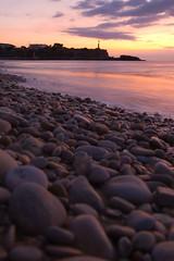 estany per guardar records (II) (conopium) Tags: sea sunrise mar cel far platja estany lametllademar pedres mediterrani lacala colorphotoaward sortidadelsol