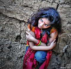 sadia 6 (noprayer4dying) Tags: red house green home girl face look fashion wall lady pose hair model eyes expression soil tip trendy highsaturation canon350d hobigonj bangladesh glamor bangles urna geans naturaltexture gamsa neazahmedphotography remakalengaforest sadiarahman