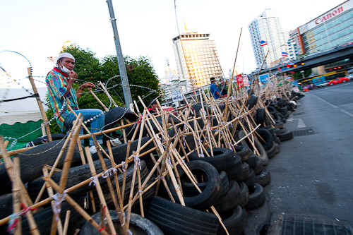 The tire and bamboo fence surrounding the red shirt camp at Lumphini Park, Bangkok