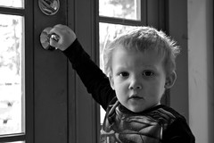 locked in (manywinters) Tags: playing ian doorknob frontporch grandnephew almosttwo