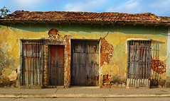 Home, sweet home (steverichard) Tags: street door house home window yellow lumix peeling paint colours sad vibrant cuba scene panasonic trinidad grille lovely cuban decorate rundown collapsing trinidaddecuba lx3 dmclx3