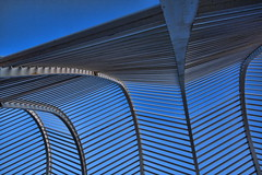 calatrava fire and ice: looking up (helen sotiriadis) Tags: blue sunset orange ice water architecture fire published athens greece olympics tilt santiagocalatrava oaka   ministract toomanytribbles