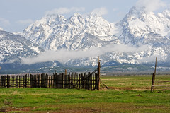 Mormon Row (bhophotos) Tags: trip travel vacation usa snow mountains nature clouds fence landscape geotagged nikon day wyoming tetons grandtetonnationalpark gtnp mormonrow 70200mmf28gvrii projectweather pwpartlycloudy