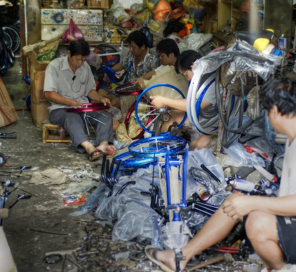 The Bicycle Builders (and I added Facebook Comments to the blog) (by Stuck in Customs)