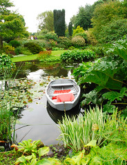 The Beth Chatto Gardens Float My Boat! (antonychammond) Tags: uk england green pond elmstead britain essex colchester dinghy bethchatto beautifulexpression mywinners abigfave saveearth anawesomeshot firsttheearth flickrdiamond flickrphotoaward internationalgeographic flickrestrellas vosplusbellesphotos landscapesshotinportraitformat lesamisdupetitprince mallmixstaraward thebethchattogardens