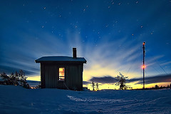 Awakening (Antti-Jussi Liikala) Tags: longexposure morning blue trees winter light shadow red sky cloud sun white mountain snow motion cold colour tree ice yellow night clouds sunrise suomi finland d50 stars lights star frozen nikon stream exposure ray glow rovaniemi horizon lappland north silhouettes fisheye arctic hut lapland rays wilderness nikkor lumi talvi lappi j 105mm thdet tunturi autiotupa kylm flickrsbest goldmedalwinner thtitaivas masto aplusphoto kalansilm goldstaraward kyrstunturi vanagram pivtupa erkmpp autiokmpp