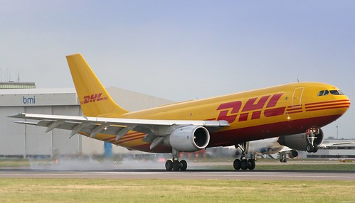 DHL Touches down on Heathrow Airports Runway 27R by   C.S Chaulk.