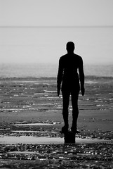 Beached (Mortarman101) Tags: sculpture art beach silhouette blackwhite sand tide crosby merseyside anthonygormley anotherplace