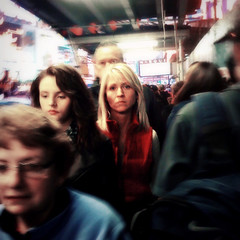 A Face in the Crowd (antonkawasaki) Tags: nyc newyorkcity movement eyecontact streetphotography explore squareformat iphone blondewoman 500x500 brunettegirl explored blurfocus thestare afaceinthecrowd antonkawasaki crowdedtimessquaresidewalk