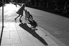 The city of running children's (43) (Donato Buccella / sibemolle) Tags: street people blackandwhite bw italy motion milan backlight children shadows candid milano streetphotography moscova canon4ood sibemolle fotografiastradale 150primavere